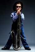 16902008-portrait-of-a-cute-little-boy-jazzman-playing-his-saxophone-retro-style
